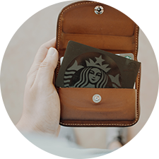 a starbucks card slotted into a wallet